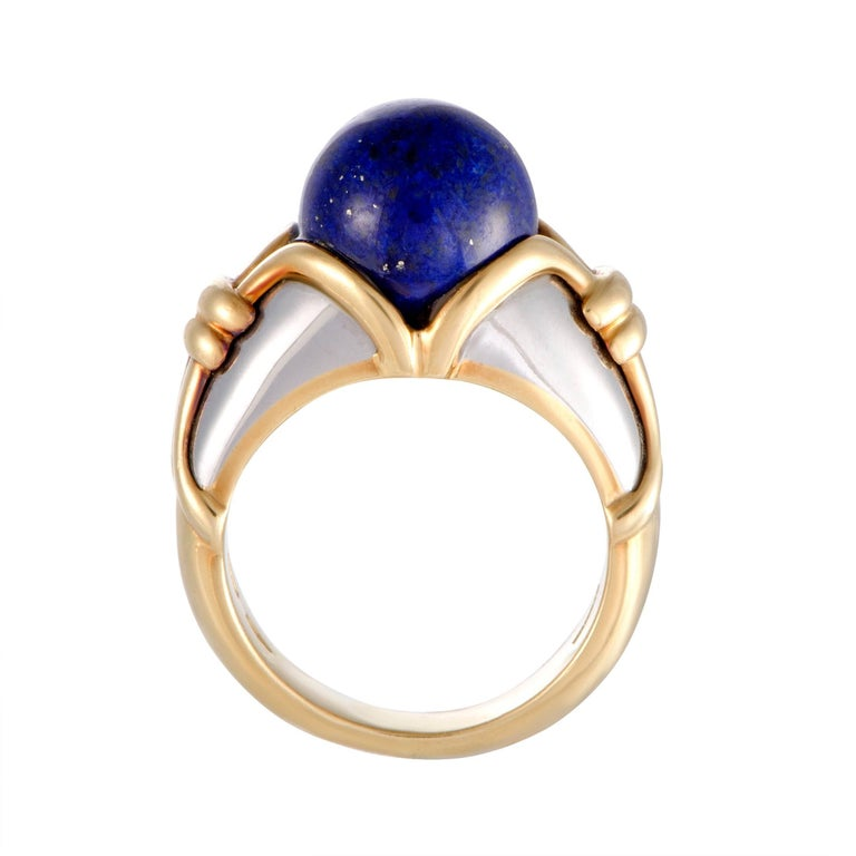 Combining 18K yellow and white gold with captivating lapis lazuli, this extraordinary ring boasts an incredibly eye-catching, fashionable appeal. The ring is a Bulgari design and weighs 10.3 grams. Included Items: Manufacturer's Box Ring Size: