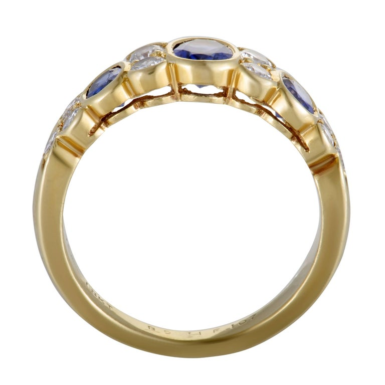 Featuring the incredibly luxurious combination of classy 18K yellow gold, glamorous diamonds and regal sapphires, this gorgeous Van Cleef & Arpels ring offers an exceptionally sophisticated appearance. The sapphires weigh in total 1.00 carat, and