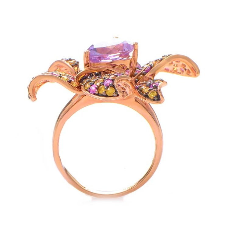 This ring from LeVian is exotic and ravishing. It is made of 14K rose gold and boasts an ~4ct kunzite stone accented with petals set with multi-colored sapphires. Retail Price: $6,895.00 (Plus Tax)
