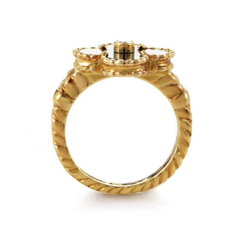 Fortune and luxury exude a pronounced presence in this fine design from Van Cleef & Arpels. 18K yellow gold is spun into twin arcing ropes. The trejectory of the band's detailed strength and texture leads to a summit of onyx pooling neatly into the