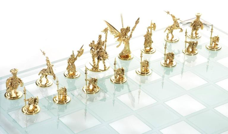 The foremost game of strategy unfolds between the most fantastic cast of characters with this unique and stunning handmade, custom designed chess set. Consider first the sheer weight of gold dedicated to this design; 62.2 grams shape the corners,