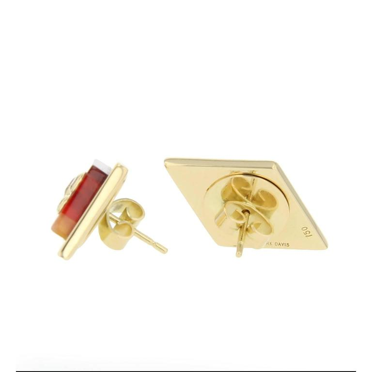 These kite-shaped stud earrings are created using laminated strips of pink and burgundy bakelite mounted in polished 18k yellow gold frames. They are adorned with fine diamonds set in 18k yellow gold bezels.  Full details below:  • From the Mark