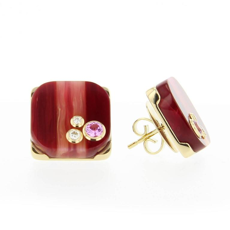 These rounded, square-shaped stud earrings are crafted using laminated burgundy and pink vintage bakelite mounted in polished 18k yellow gold. Set with fine pink sapphires and diamonds in 18k yellow gold.  Full details below:  • From the Mark Davis
