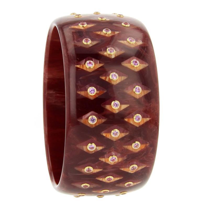 Burgundy Bakelite, pink sapphire and yellow gold bangle