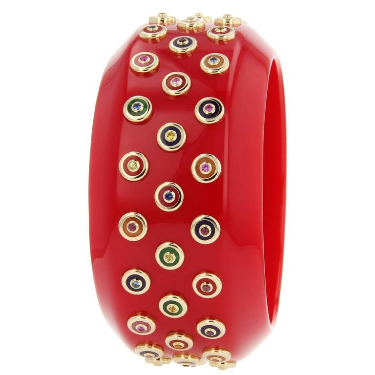 Red Bakelite, amethyst, citrine, garnet, peridot, sapphire and gold bangle