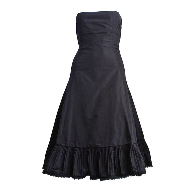 2003 ALEXANDER MCQUEEN black taffeta dress with pleated hemline trimmed in fur