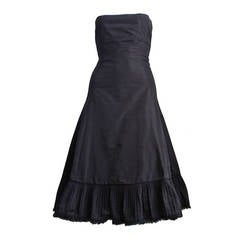 2003 ALEXANDER MCQUEEN black taffeta dress with pleated hemline trimmed in fur