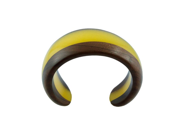 This modern and spectacular bracelet is totally hand carved made in wood and yellow methacrylate.