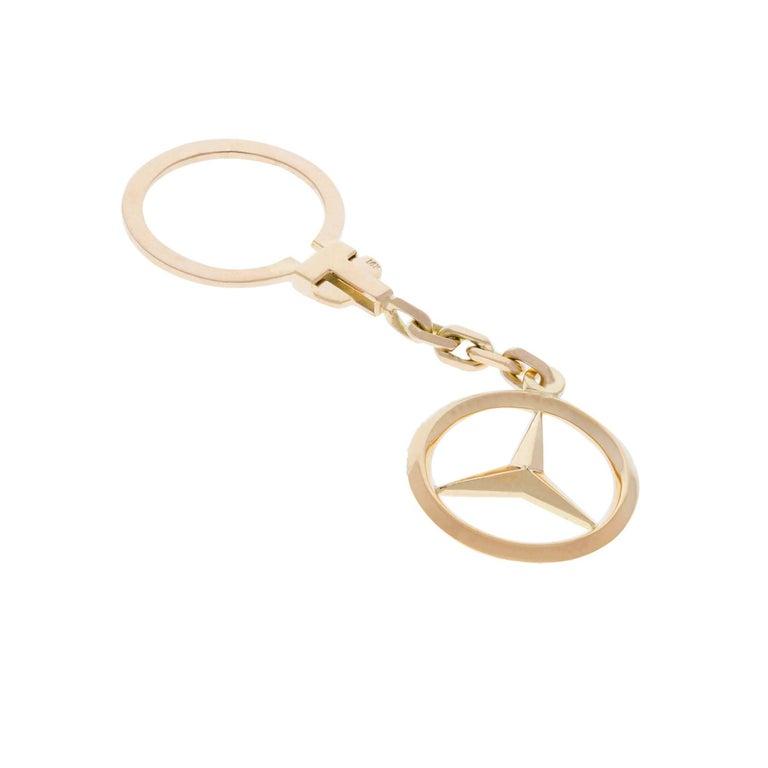 14K Mercedes Benz key ring.