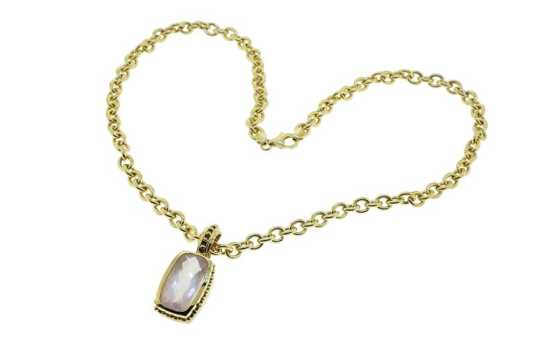 Mazza 14K yellow gold bezel set faceted rose quartz enhancer. The stone measures 21mm x 13mm.  Enhancer ONLY Chain can be purchased separately.