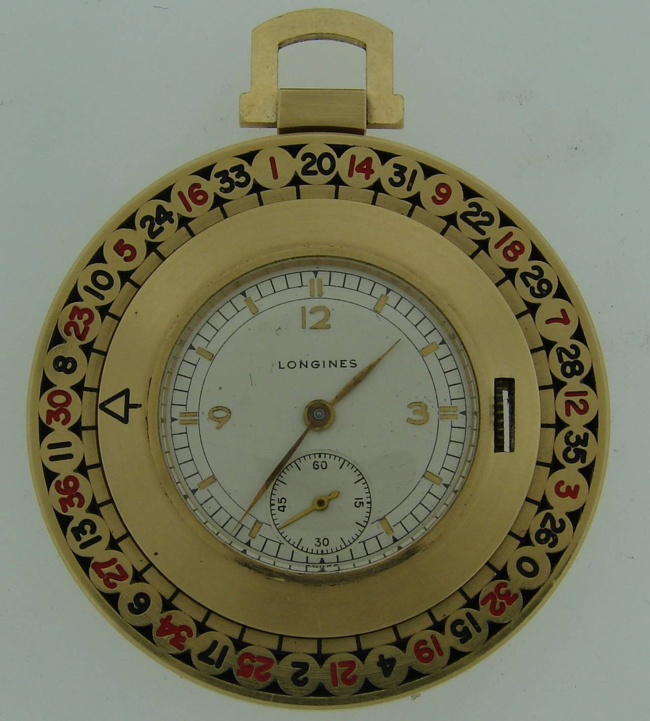Have Las Vegas in your pocket! - stunning pocket watch made as a roulette. The outer circle with numbers is turning! You can gamble anywhere anytime!   The watch is made of 14K (tested) yellow gold and enamel. The watch is 1-5/8