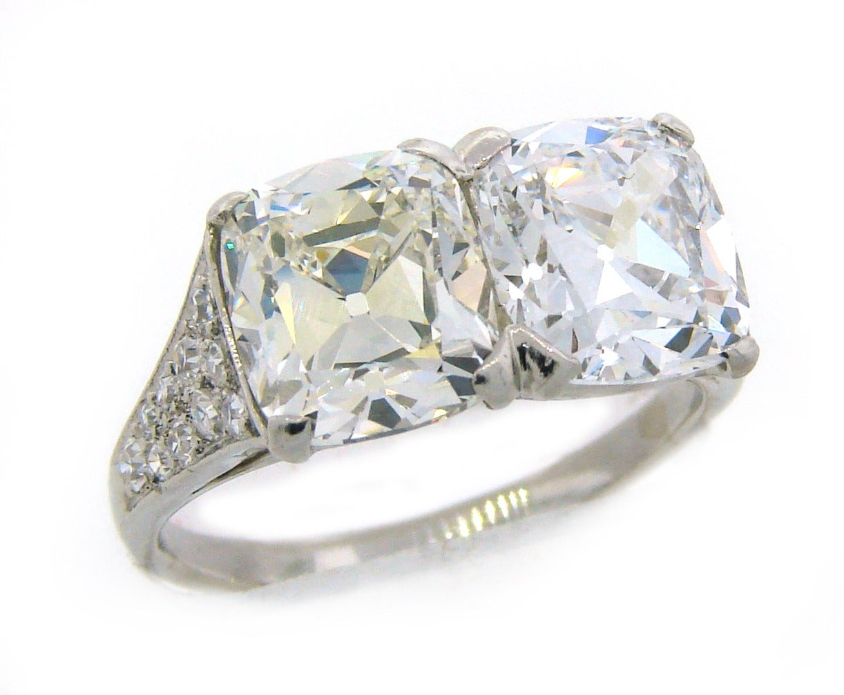 Magnificent Art Deco two-stone ring created by Cartier in the 1920s. it features two cushion cut diamonds - one is 2.71 carat (I, VVS2) and the other one is 2.52 carat (D, IF). The diamonds are accompanied with GIA certificates (please see pictures