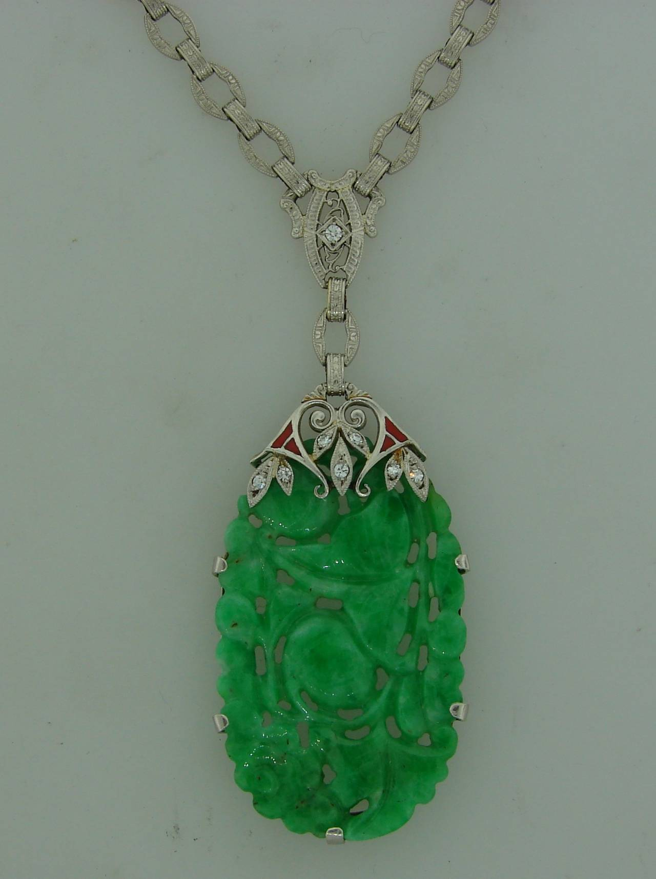Art deco carved jade enamel diamond platinum necklace pendant at 1stdibs gorgeous art deco necklace featuring a carved jade set in platinum and accented with single cut aloadofball Images