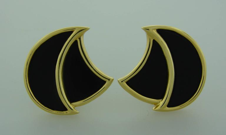 """Understated and elegant clip-on earrings created by Henry Dunay in the 1970's. Made of black onyx and 18k (stamped) yellow gold.  The earrings measure 1-1/8"""" x 1-1/8"""".  They are clip-on, posts can be added.  Stamped with a hallmark for 18k gold"""