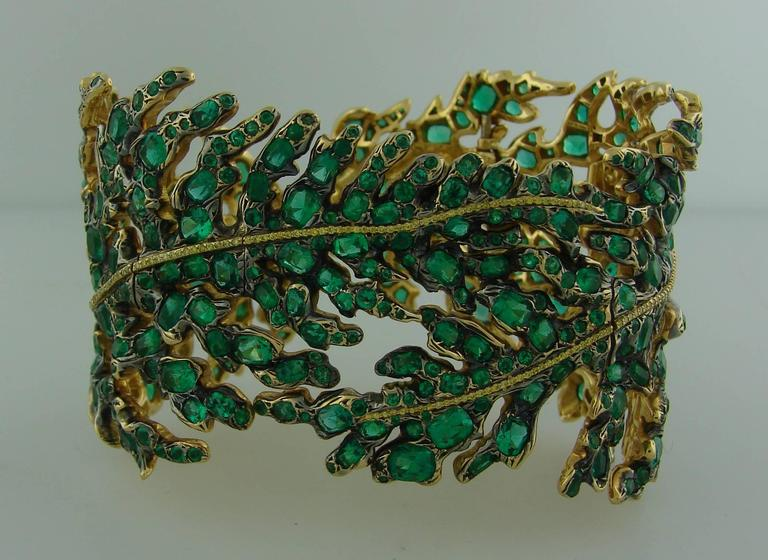 Magnificent fascinating bracelet created by Michele Della Valle in the 1990's. Bewitched floral design. The bracelet is made of 18k white and yellow gold and encrusted with emeralds and fancy yellow gold diamonds. Beautiful color combination! The