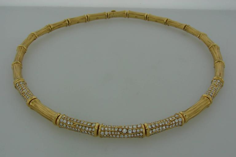 Signature Cartier Bamboo necklace, chic and timeless. It will make a great addition to your jewelry collection. It is made of 18k yellow gold and set with round brilliant cut diamonds. The diamonds are F-G color, VS1 clarity, total weight