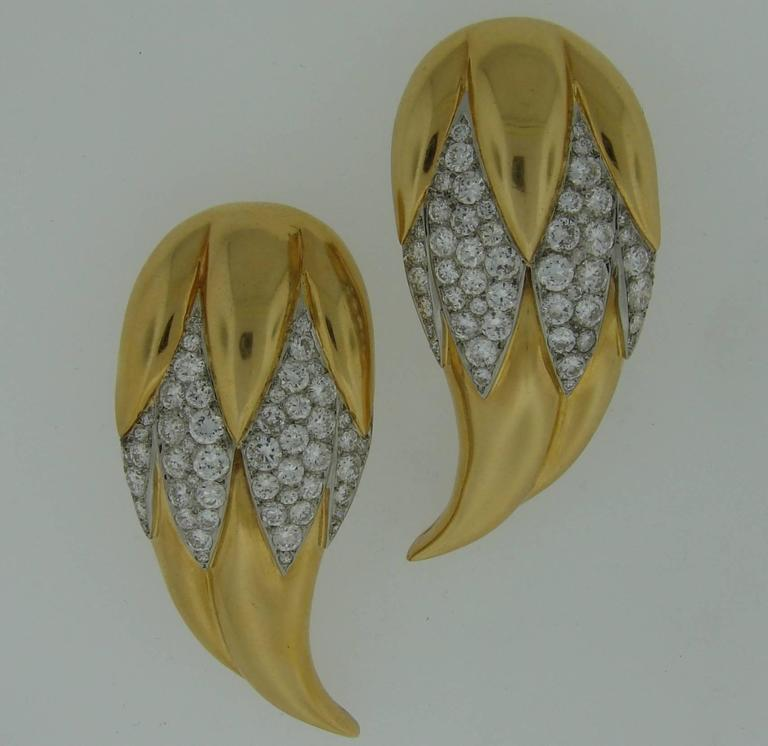 A pair of magnificent double clips designed by Suzanne Belperron and manufactured by company B. Herz in Paris between 1932 and 1940. The piece comes with an authentication certificate from Belperron LLC (see picture 10).  The brooches are made of