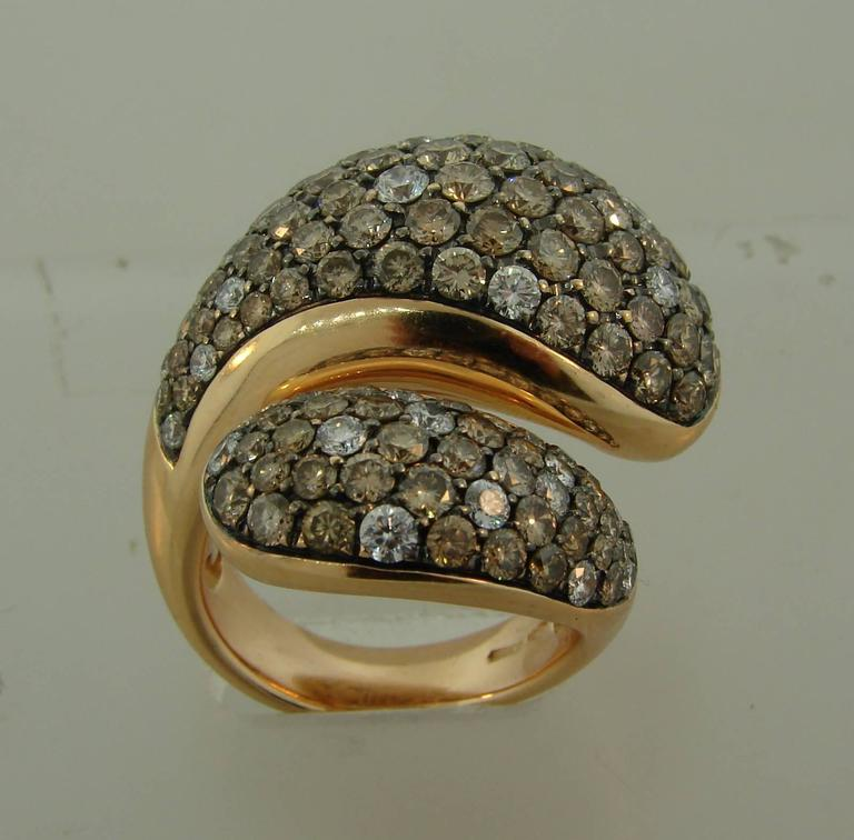 Fabulous stylized snake ring created by De Grisogono in Italy. Gracious lines, perfect proportions, tasteful color combination, volume achieved by setting the diamonds in the blackened gold, outstanding workmanship make the ring bold yet elegant,