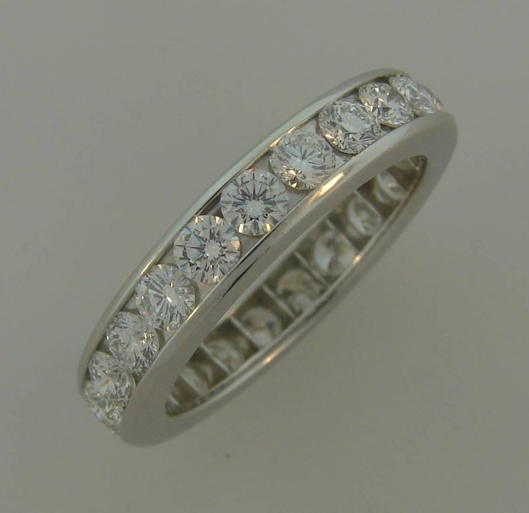Classy and timeless diamond eternity band created by Tiffany & Co.  Made of platinum and set with twenty three round brilliant cut diamonds approximately 0.10-carat each. Diamonds are F-G color VVS2 clarity, total weight approximately 2.30
