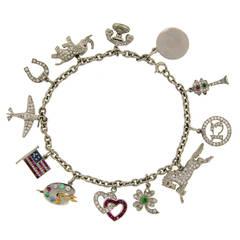1920s Tiffany & Co. Art Deco Gems and Platinum Charm Bracelet