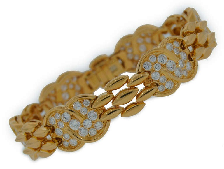 Feminine and elegant bracelet created by Van Cleef & Arpels in Paris in the 1990's. Timeless design, classic combination of diamonds and yellow gold. Beautiful and wearable piece!