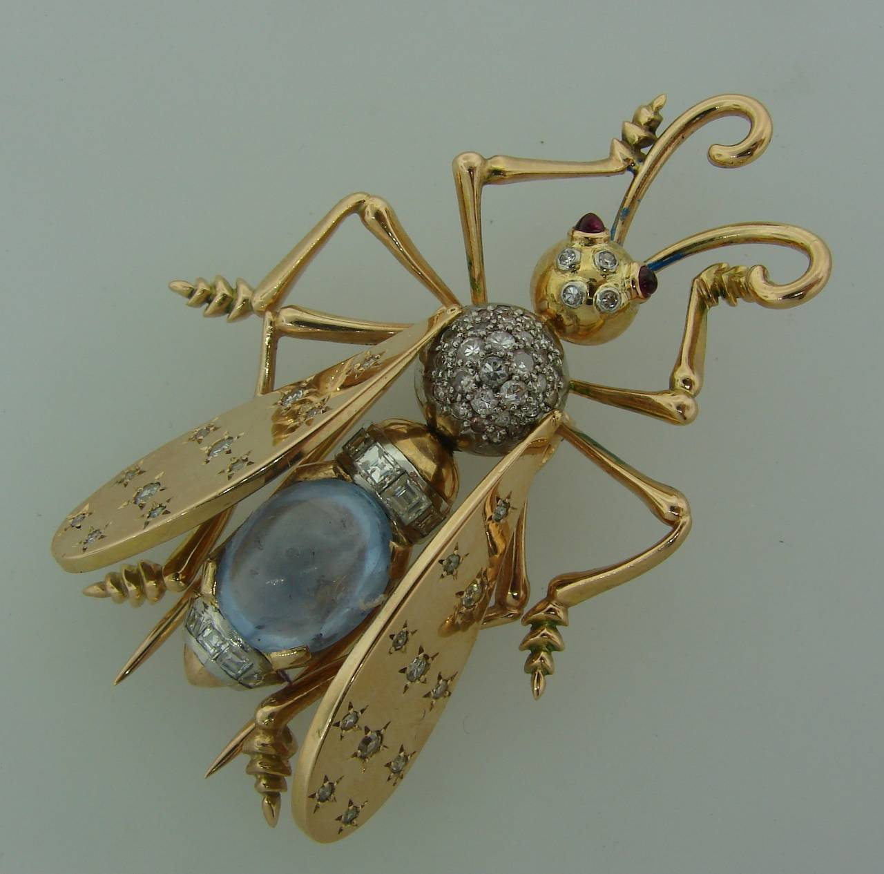 The cutest fly pin! Definitely a conversational piece and will accentuate your extravagant personality!