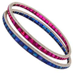 VAN CLEEF & ARPELS Art Deco Pair of Ruby Sapphire & Platinum Bangle Bracelets
