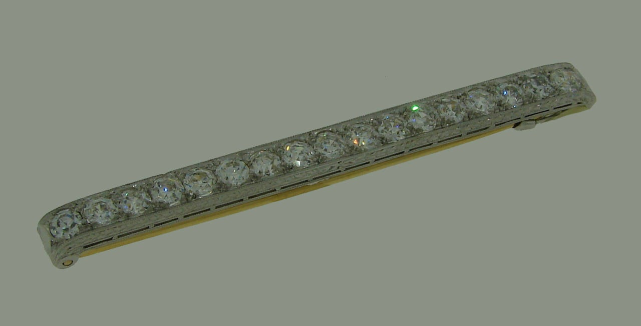 Classy Art Deco Tie Bar pin created by Tiffany & Co. in the 1920's. Made of platinum (tested); the pin is made of 18k yellow gold (tested). Features seventeen very rare Marigold cut diamonds, total weight approximately 2.55 carats (H color, VS