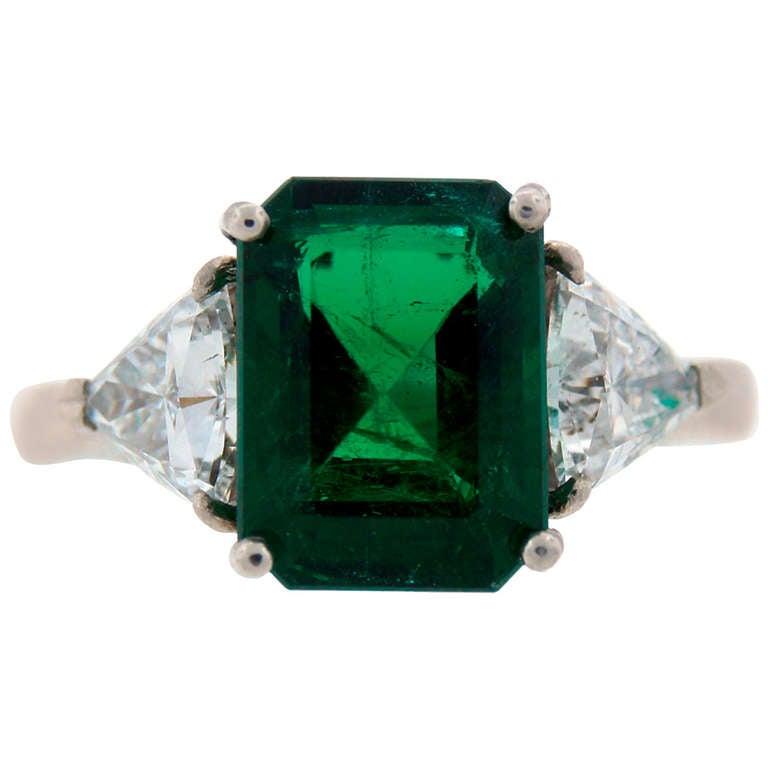3 70 carat emerald diamond platinum three stone ring at