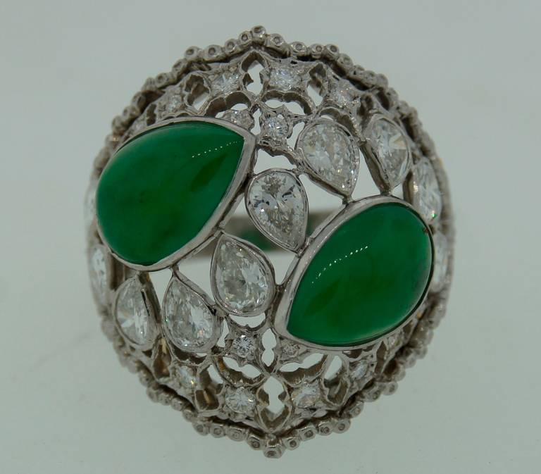 Magnificent cocktail ring created by Buccellati in Italy in the 1970s. Features two pear-shape jade and ten pear-shape diamonds set in platinum and sprinkled with round diamonds. Gorgeous openwork with filigree craftsmanship on platinum with yellow