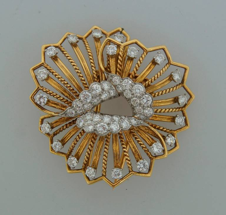 French chic diamond & yellow gold pin created by Cartier in Paris in the 1960's. Designed as a stylized yellow gold flower encrusted with round brilliant cut diamonds - total weight approximately 3.0 carats (F-G color, VS1 clarity).  The pin