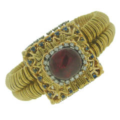 Pierre Sterle Gold Garnet Diamond Sapphire Watch circa 1940s Jaeger leCoultre