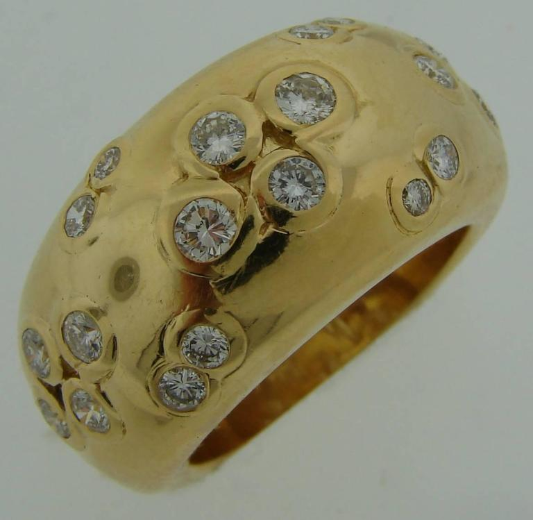 Bold yet elegant ring created by Cartier in Paris in 1994. Classy and timeless design, Perfect lines.  The ring is made of 18k yellow gold and set with round brilliant cut diamonds (total weight approximately 0.89 carat).  The ring is size 6