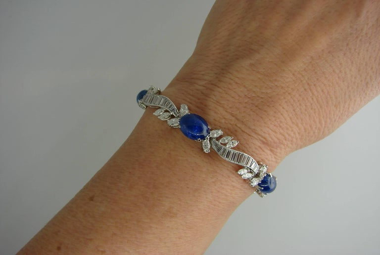 Magnificent classy and elegant bracelet created by Van Cleef & Arpels in the 1960's. Features five cabochon sapphires and multiple baguette cut and marquise cut diamonds set in platinum.