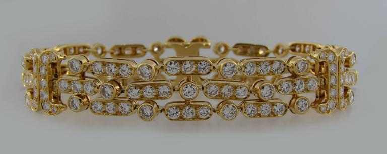Classy and timeless bracelet created by Van Cleef & Arpels in France in the 1980's. Feminine, elegant and sparkly, the bracelet is a great addition to your jewelry collection.  It is made of 18 karat (stamped) yellow gold and encrusted with round