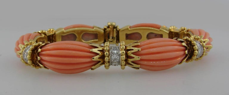 Elegant and stylish bracelet created by Van Cleef & Arpels in France in the 1970's. Feminine, classy and wearable, it is a great addition to your jewelry collection.  Made of carved coral and 18 karat yellow gold and accented with round