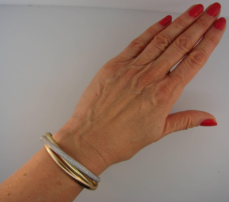 Cartier Diamond Three-Tone Gold Trinity Bangle Bracelet In Excellent Condition For Sale In Beverly Hills, CA