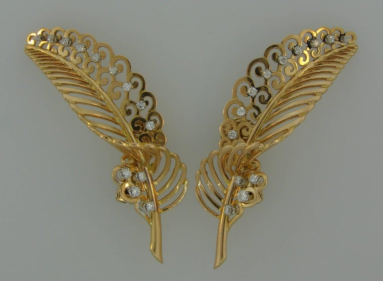 Beautiful feminine earrings created in France in the 1950s. Different and wearable, the earrings are a great addition to your jewelry collection.  Made of 18 karat yellow gold and set with Old European cut diamonds (H-I color, VS clarity, total