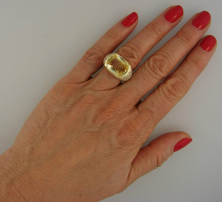 Magnificent cocktail ring created by Van Cleef & Arpels in New York in the 1980s.  Bold yet elegant and feminine, the ring is a great addition to your jewelry collection.  Features an approximately 12-carat cushion cut yellow sapphire tastefully