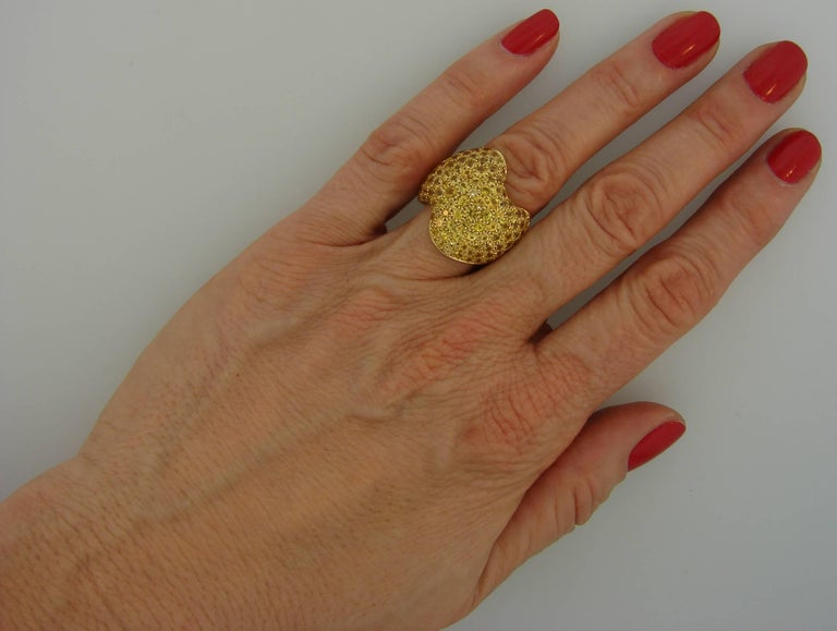 Elegant and classy ring created by Van Cleef & Arpels in France in the 1980s. Timeless, wearable and chic, the ring is a great addition to our jewelry collection. Made of 18 karat yellow gold and encrusted with yellow sapphires.  The ring is 1