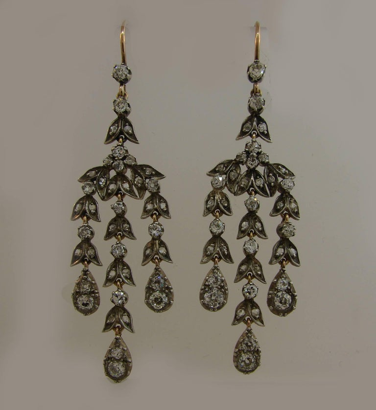 Fabulous Victorian dangle earrings. Classy, timeless, feminine and wearable, they are a great addition to your jewelry collection.  Made of yellow gold topped with silver and set with old mine and rose cut diamonds (total weight approximately 2.50