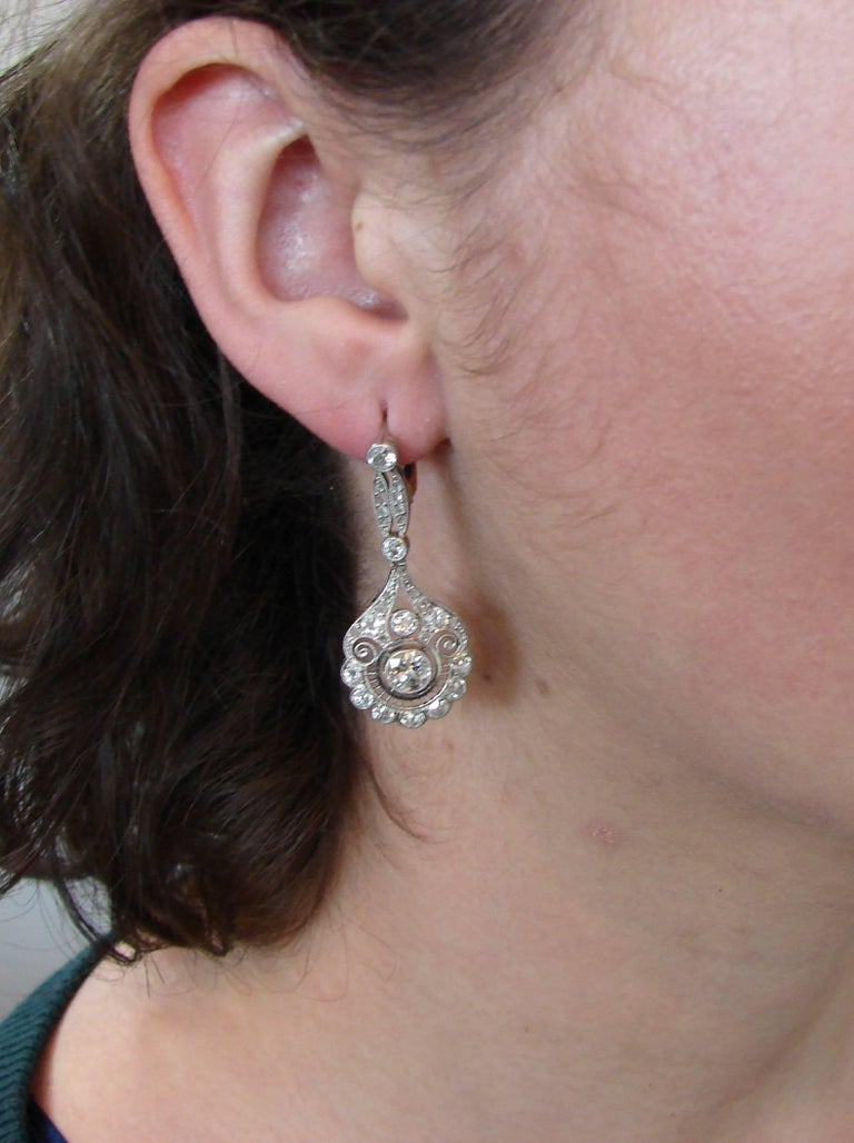 Fabulous Art Deco dangle earrings. Classy, timeless, feminine and wearable, they are a great addition to your jewelry collection.  Feature two Old European cut diamonds approximately 0.65-carat each set in platinum, encrusted with Old European, mine