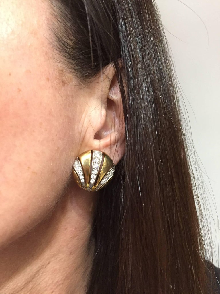 Classy and timeless ear clips created by Van Cleef & Arpels in the 1980s.  Feminine, wearable and French chic, the earrings are a great addition to your jewelry collection. Made of 18 karat yellow and white gold and set with round brilliant cut