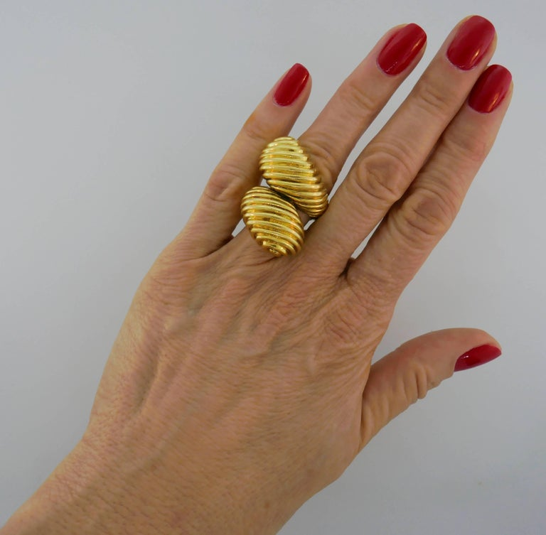 Bold cocktail ring created by David Webb in the 1970s. It is made of 18 karat yellow gold and designed as a stylized snake. Sharp, chic, prominent and wearable, the ring is a great addition to your jewelry collection. The ring is size 5.5-6. It is