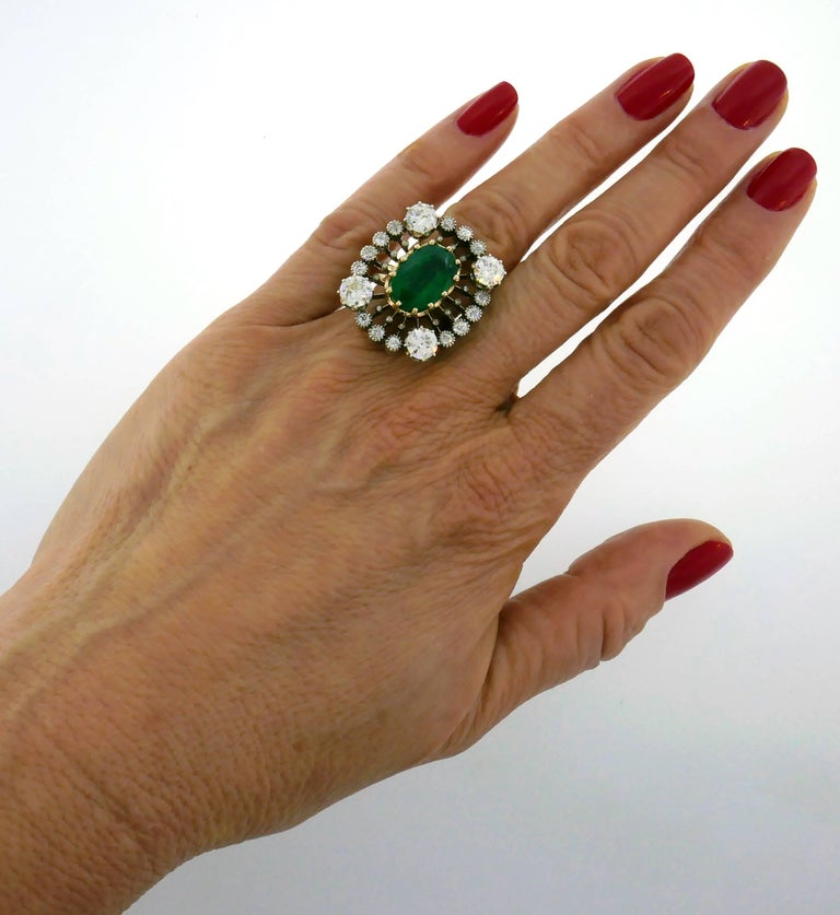 Beautiful Victorian cocktail ring featuring a 5.70-carat emerald in openwork setting accented with Old European cut diamonds. Different, prominent and wearable, the ring is a great addition to your jewelry collection.  The top of the ring is made of