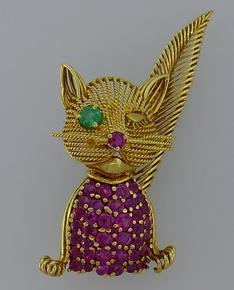 Lovely cat clip created by Tiffany & Co. in the 1960s. Articulated, cute and wearable, the pin is definitely a conversational piece and is a great addition to your jewelry collection.  It is made of 14 karat (tested) yellow gold, and encrusted with