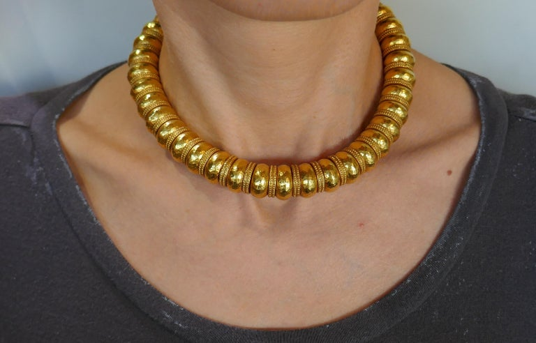 Fabulous necklace created by a Greek designer Ilias Lalaounis. Bold and wearable, the necklace is a great addition to your jewelry collection.  Made of 22 karat (stamped) yellow gold.  The necklace measures 15-1/8 x 5/8 inches (38 x 1.4 cm) and