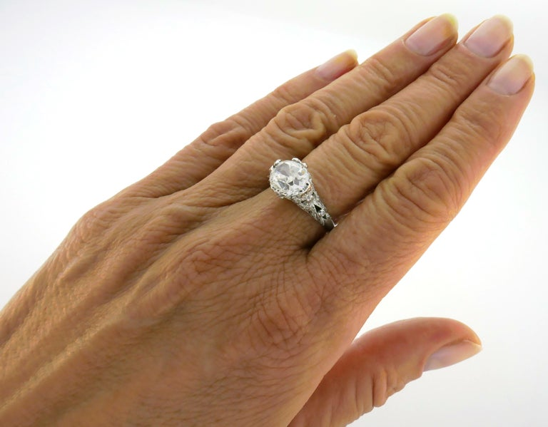 Amazing diamond & platinum engagement ring. Features a gorgeous over 3-carat cushion cut diamond that comes with a GIA certificate (see picture 10) stating that the diamond is G color and SI1 clarity. The diamond is old cushion cut, very lively and