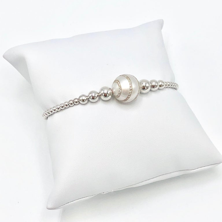 18K White Gold South Sea Pearl and Diamond Bangle designed with .28 Carat Weight Diamonds set in the Pearl.  Flexible Bangle which separates at the back to comfortably place on wrist and remove. Magnet clasp. New, never worn.    Made in Italy