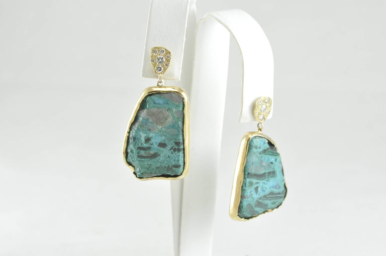 22K Yellow Gold, Chrysocolla and Diamond Earrings from hot new designer: Rocky Gem Designs. This amazing set of earrings has diamond in 22k gold with beautiful chrysocolla stones in the center of more 22k gold.  The asymmetrical shape of the stones